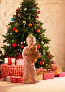Little girl by the christmas tree