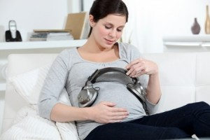 pregnant mom playing music for her baby