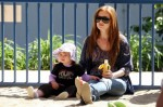 Isla Fisher and her daughter Olive Cohen play at the park