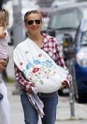 Jennifer Meyer cuddles her new baby