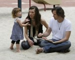 Milla Jovovich with boyfriend Paul Anderson and daughter Ever