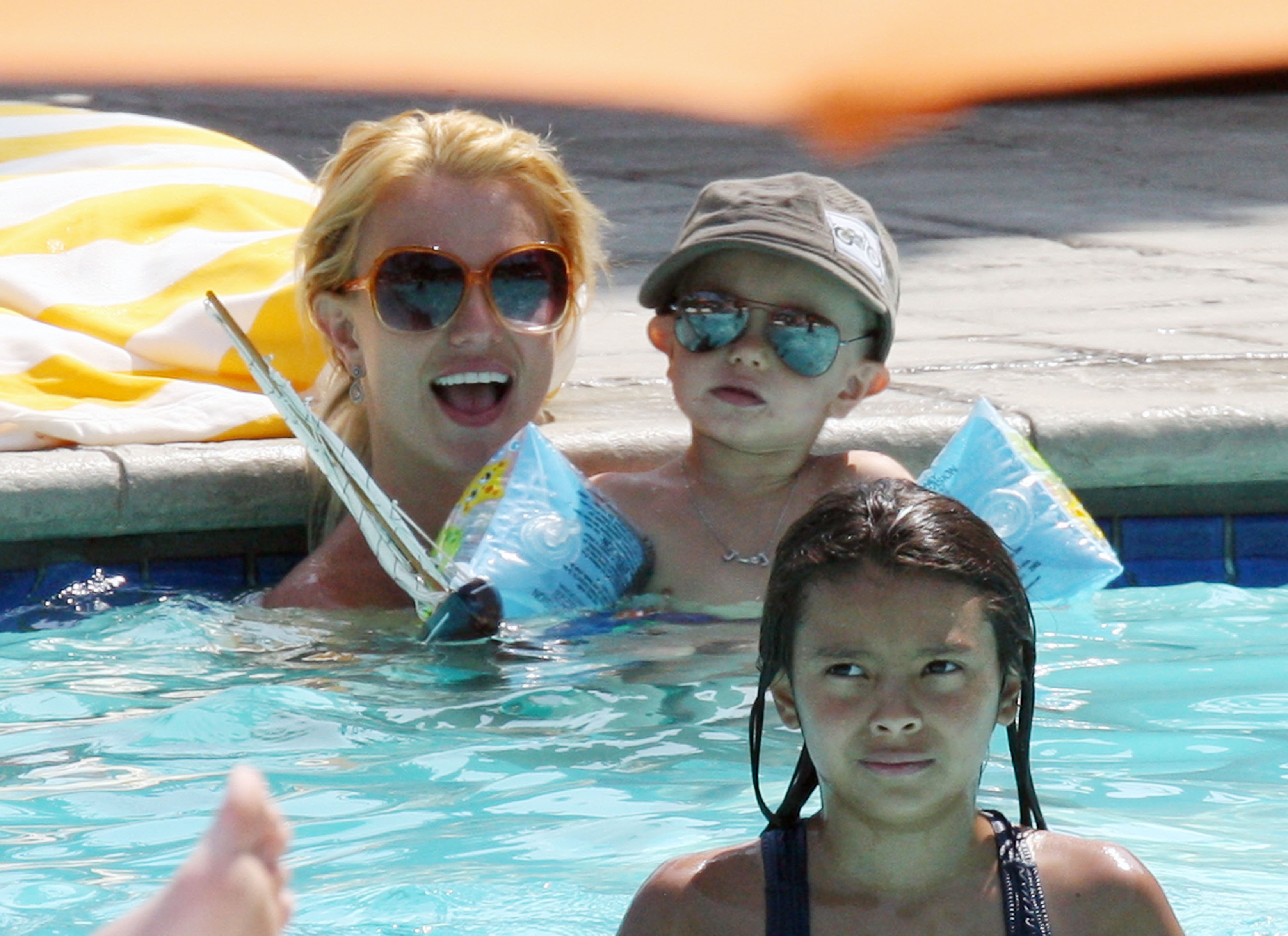 Britney Spears Hangs Out Poolside With Her Boys Growing