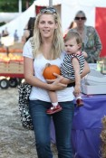 Busy Philipps and her daughter Birdie Silverstein pick pumpkins
