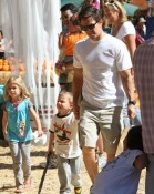Mark Wahlberg and his two oldest children Ella and Michael pick pumpkins