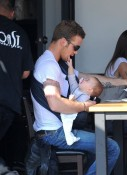 Cam Gigandet holds his daughter Everleigh while he has lunch