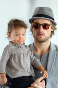 Gabriel Aubry with daughter Nahla at the airport