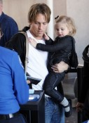 Larry Birkhead and daughter  Dannielynn arrive at LAX