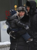 Julianna Margulies, her husband Keith Lieberthal and son Kieran bundles up