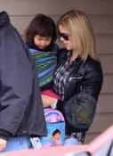 Elin Nordegrin carries her daughter Sam Woods