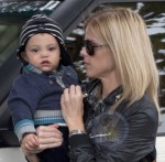 Elin Nordegrin carries her son Charlie