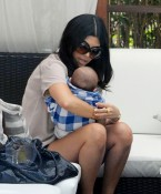 Kourtney And Mason Cuddle Poolside in Miami