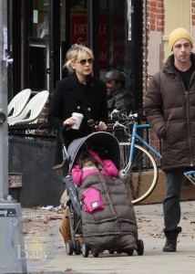Michelle Williams pushes A bundled up Matilda