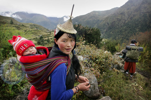 A Mom Hikes With Her Baby In Laya North West Bhutan
