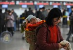 Mom waits for her flight at the International Airport in Urumqi, China