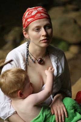 mom breast feeding an older child