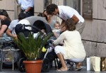 Roger and Mirka tuck one of their twins into their stroller