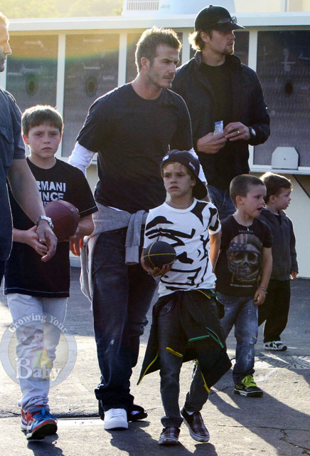 David and Tom with their boys Brooklyn, Romeo, Cruz and John Moynahan