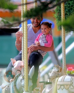 Emme Anthony with security on the carousel