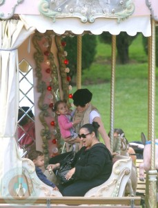 Jennifer Lopez Holding Emme, while a nanny looks after Max