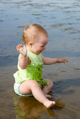 Little Girl Enjoying The Beach