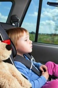 little girl in a car