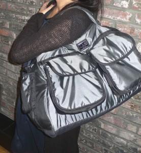 Woman Wearing Voyage Diaper Bag