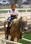Nahla Rides a Horse at the park