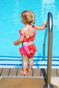Toddler at a swimming pool