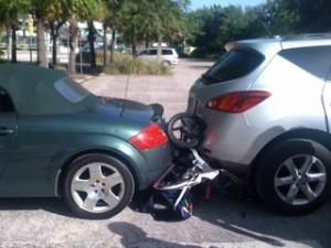 Bob Revoltuion stroller sandwiched between 2 vehicles