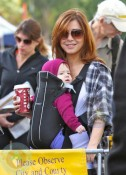 Alyson Hannigan wearing daughter Satyana