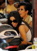 Kim Kardashian makes faces at nephew Mason