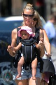 Heidi Klum wearing daughter Lou