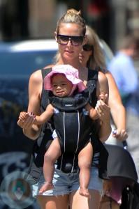 Heidi Klum wearing daughter Lou