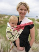 Model wearing PUJ sling in Cannon Beach brick