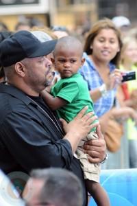 Usher Raymond V with a bodyguard