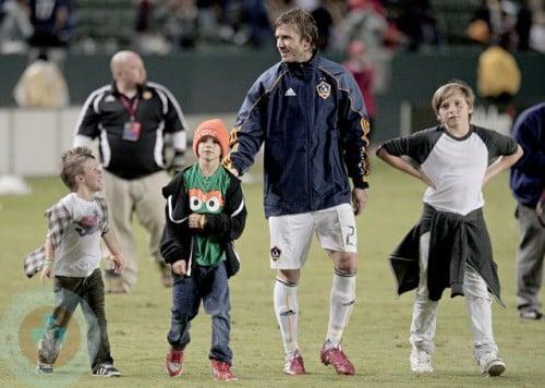 David Beckham walks with sons(l-r) Cruz, Romeo and Brooklyn