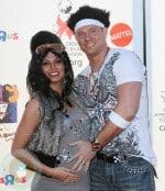 An expectant Melissa Rycroft and husband Tye Strickland