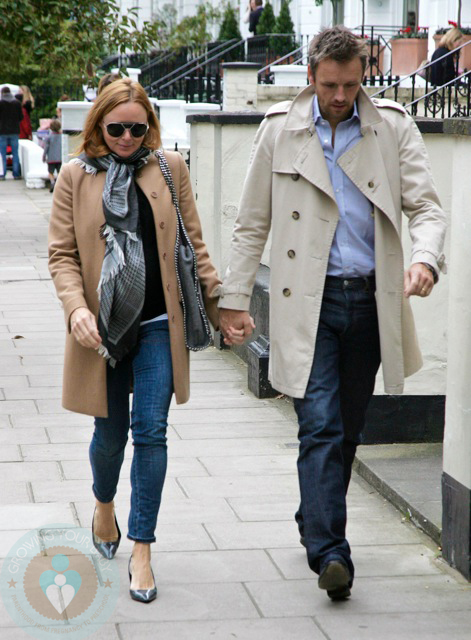 A pregnant Stella McCartney strolling with husband Alasdhair Willis