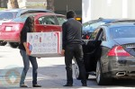 Associates loading a Chicco Cortina Stroller into Ali Larter's car