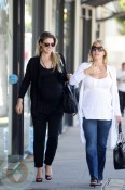 Ali Larter strolls with a friend