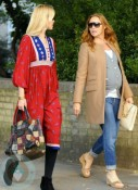 A pregnant Stella McCartney strolling with Claudia Schiffer