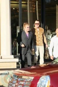 David Furnish and Sir Elton John shopping at Neiman Marcus on Dec26th