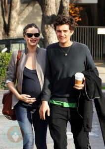 Pregnant Miranda Kerr out for a walk with husband Orlando Bloom