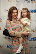"""Milla Jovovich and Ever at the Access Hollywood """"Stuff You Must..."""" Lounge"""