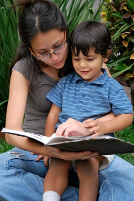 toddler and mom reading