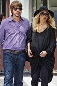 A pregnant Rachel Zoe and husband Roger Berman