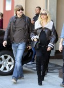 A pregnant Rachel Zoe and husband Roger Berman