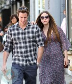 An expectant Devon Aoki and her fiance James Bailey