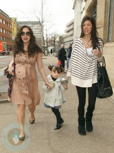 A very pregnant Myleene Klass with daughter Ava