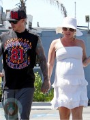 A pregnant Pink (Alecia Moore) and husband Carey Hart